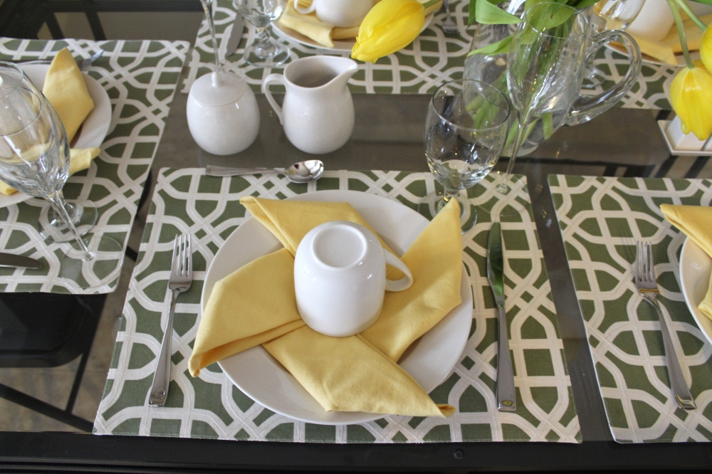 Sunny Pinwheel Fold Napkins on Green Placemats