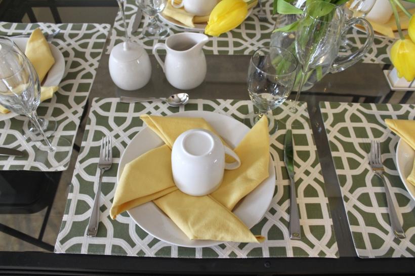 Sunny Pinwheel Fold Napkins on Green Placemats