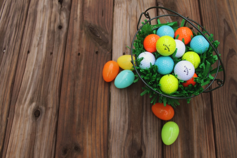 I used a driving range bucket to replace the traditional Easter basket.